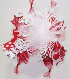 Bling it On Santa Over the Top Hair Bow with matching headband. $19.99, via Etsy.