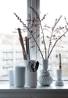 Beautiful porcelain by Lyngby, in a windowsill. Decorated with different things.