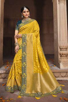Yellow color silk traditional saree with a matching teal silk blouse #banarasisarees #banarasisareelookforwedding #banarasisareeblousedesign #banarasisilksaree #banarasisareeblousedesignslatest #sareestyles #saree #sareewedding #sareegown #sareedesignspartywear #indianweddingoutfits #indianfashion #indiandesignerwear #indianbridalfashion #weddingdresses #wedding #bridalblousedesigns Latest Sarees Online, Indian Sarees Online, Designer Sarees Online, Art Silk Sarees, Banarasi Sarees, Fancy Sarees, Party Wear Sarees, Yellow Saree, Work Sarees