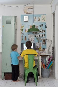 Love the green pendant light and vintage metal chair at the desk.  Also, love the idea of having lockers in a boys room for storage.