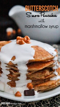 I don't think pancakes get any BETTER than this! Forkfuls of butterscotch, chocolate, graham cracker pancakes smothered in marshmallow syrup. Pancakes amazing. Marshmallow syrup, amazing (and only 2 ingredients)!