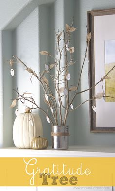 """DIY Thanksgiving Gratitude Tree....made from old tree branches and burlap wired leaves. Hanging from each leaf, is an item of """"gratitude"""". A great display for the holidays! www.makeit-loveit.com"""