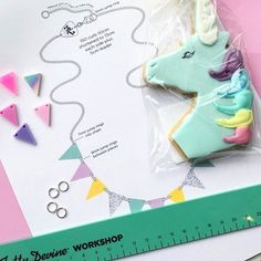 "tattydevine:  ""Pastel rainbow bunting and unicorn biscuits at our colourful jewellery making workshop!  """