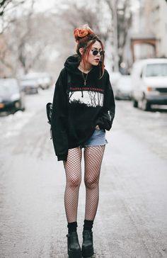 Nirvana hoodie over denim cutoff shorts. Fishnets & black socks. Black combat boots, black packpack, choker, necklace, & black aviators