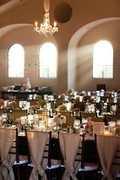 I love the fabric on the chairs and the natural light filtering through the venue. Gorgeous!