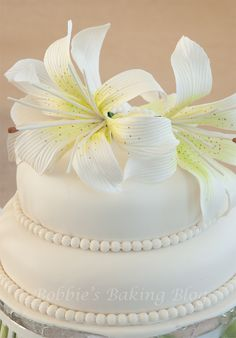 Genoise cake with fondant and marzipan, with lilies!