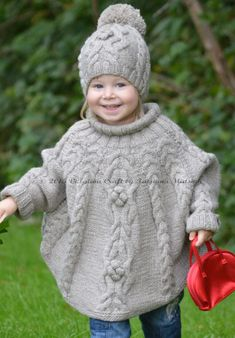 Knitting Pattern for Temptation Poncho - Cabled poncho with sleeves and matching hat. Toddler and child sizes 2–3 years; 4-5 years; 6-7 years; 8-9 years; 10-12 years. Bulky weight yarn. Designed by Tatsiana Matsiuk