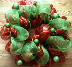 Another twist on a classic holiday wreath with this fab deco mesh in mettallic red and lime green that is oh so fun!