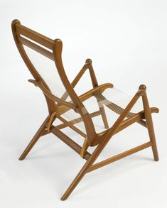 Helge Vestergaard Jensen; Teak, Nylon String and Brass Armchair for Peder Petersen, c1957.
