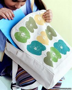 Apples aren't just for eating. The cut side of an apple half, dipped in candy-colored paint, can be stamped onto otherwise ordinary canvas tote bags and backpacks.
