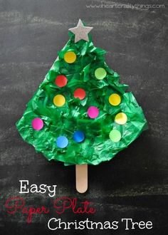 Easy Paper Plate Christmas Tree Craft for Kids. Using dot stickers to decorate the Christmas Tree makes this super simple and fun! From iheartcraftythings.com