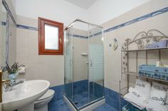 The bathroom of the Villa of Roses that sparkles with purity with shower cabin. Shower Cabin, Living Room With Fireplace, Double Bedroom, Beautiful Islands, Ground Floor, Beautiful Gardens, Sparkles, Villa, Roses