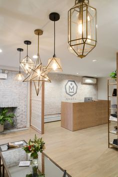 """The <a href=""""http://www.westelm.com/shopping/brass-pendant-lighting/"""" target=""""_blank"""">brass pendants from West Elm</a> are simply stunning."""