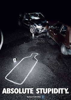 Heavy contrast with dark shadows. The highlight is on a white outline of an Absolute vodka bottle on the black pavement. That point is aligned to direct the viewers' eye to the car crash.