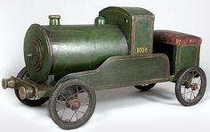 This fabulous child's Folk Art ride-on train has been hand made for a lucky child. It has the original paint, leather seat and is in fine working condition. English, circa 1910.