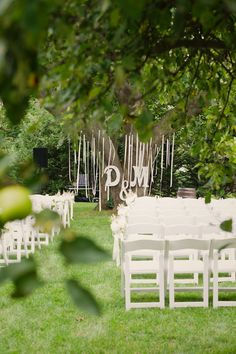 Streamer and monogram ceremony backdrop.