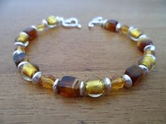Original silver and gold tone beaded bracelet by tcupcreations, $20.00