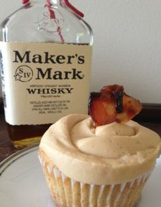 """""""Mancakes"""" Vanilla bourbon cupcakes w walnuts and choc chips, topped with peanut butter bourbon frosting and candied bacon."""