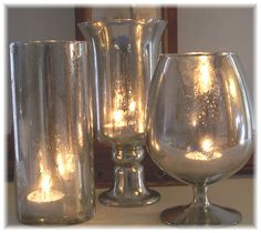 """mercury glass tutorial - spray with Krylon mirror-like spray paint, wait 20 seconds, and """"spritz"""" with spray bottle of plain water.  Let dry. Fill glass vessels with tea lights or greenery.  Also use to make mercury ornaments."""