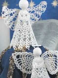 Praying Angel Ornaments  A pair of pristine angels stand silently showing their devotion.  Designed by Constance Thomas  free pdf from free-crochet.com