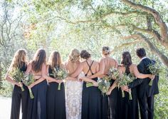Bride and Bridesmaids Backs in a Forest    Photography: Willa Kveta Photography   Read More:  http://www.insideweddings.com/weddings/romantic-outdoor-bohemian-chic-wedding-at-a-santa-barbara-park/755/