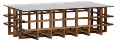 At once structural and light, this handcrafted coffee table features open walnut…