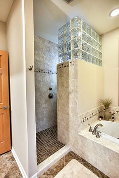 walk in shower with have tiled wall and glass block