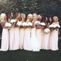 Bride has pink bouquet, bridesmaids have white.