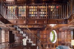 The library is striking, with mahogany wood-paneled walls spanning two levels.  - TownandCountrymag.com
