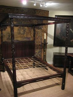A RARE 16TH CENTURY ENGLISH OAK FOUR POSTER BED.