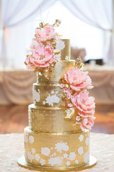 Elegant gold 6 tier buttercream cake with sugar peonies and lace