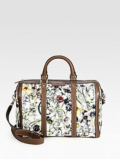 """Gucci Vintage Web Flora Canvas Boston Bag  Mini infinity print flora canvas Maple brown leather trim Light gold hardware Double handles, 3.5"""" drop Adjustable and detachable shoulder strap, 20"""" drop Zip-top closure Interior zip and smart phone pockets Linen lining Medium size: 13""""W x 8.7""""H x 7""""W Made in Italy"""
