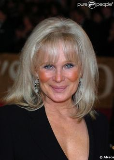 Linda Evans still so naturally beautiful. Those cheek bones, smile and eyes enough to make any man crumble at her feet!