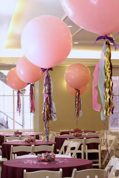 Balloon centerpieces - thought they would look like jellyfish if they had a clear balloon over them.