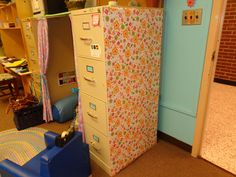 Add wrapping paper to a boring filing cabinet. You can laminate the wrapping paper to make it more durable. You can change the paper if you decide on a new design.