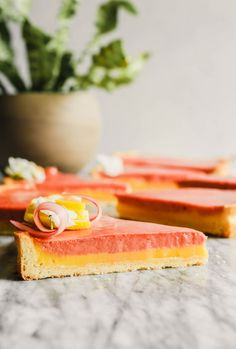 This layered rhubarb tart strikes the perfect balance between sweet and tart. La… This layered rhubarb tart strikes the perfect balance between sweet and tart. Layers of rhubarb curd and lemon curd combine to create a show stopping dessert! Rhubarb Desserts, Rhubarb Recipes, Tart Recipes, Just Desserts, Sweet Recipes, Baking Recipes, Delicious Desserts, Dessert Recipes, Yummy Food