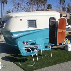 Vintage camper. I love the fin-like projections! This would look great pulled by one of those big boat chevies with the fins!