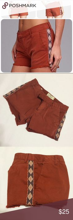 Lucky Brand Embroidered Shorts Rust / sienna colored chino shorts by Lucky Brand feature a tribal embroidered design in cream and navy going up both sides, frayed hems, front pockets, and have a button/zip closure. Size 25/0. Label says Sienna Chino. Pre-loved but lots of wear left in these unique shorts. Goes with many different things, and definitely perfect for the boho/festival look. Lucky Brand Shorts
