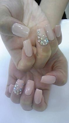 Nude nails with crystal accent nail