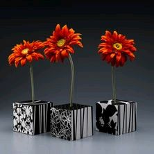"Modern Flower Cubes-  -Three 5"" Styrofoam cubes  -Five coordinating patterns, 12"" x 12"" --sheets, decorative paper  -Three Orange silk gerbera daisies,  -Paper trimmer or scissors  -Craft knife with sharp blade  -Low-temp glue gun and glue sticks  -Thick white craft glue  -Pencil  -Ruler"