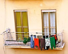 Why do I like seeing laundry hanging on a balcony?