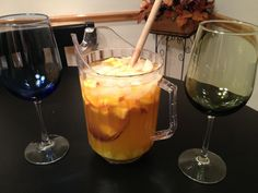The best Peach Sangria you will ever have! 1/2 (big) bottle of Barefoot Pinot Grigio, 1/2 cup peach schnapps (maybe 3/4), 1/2 cup ginger ale, 3/4 cup of Dole orange mango peach juice, 1 whole peach, cut into small squares.
