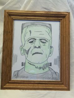 This is a 8 x 10 of Frankenstein with colored pencil on artist paper. In frame with glass and signed.