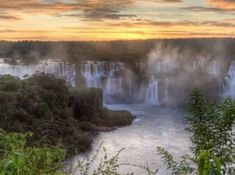 The Iguazu Falls which runs from Brazil to Argentina is known to be the most beautiful waterfall in the world. In fact it is said that the United States first lady Eleanor Roosevelt said Poor Niagara! when she first saw the Iguazu Falls. Beautiful Places In The World, Places Around The World, Places To Travel, Places To Visit, Travel Destinations, Travel Deals, Iguazu Falls, Photos Voyages, Parc National