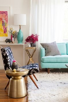 mint couch, gold table, navy chair...great color combination