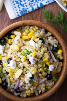 An easy summer barley salad with grilled corn, blueberries, goat cheese and almonds, all tossed in a simple white wine vinaigrette. Perfect picnic food!