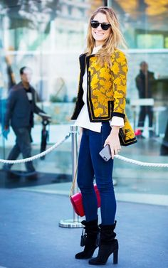 A button-down shirt is worn with a jacquard tailored jacket, skinny jeans, red chain bag, and black boots