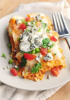 Mexico meets Buffalo in this Buffalo Chicken Enchiladas recipe.