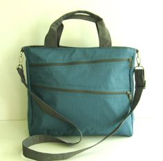 Water Resistant Nylon Bag in Dark Sky Blue with khaki straps and zippers.