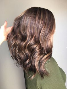 Chocolate brown balayage. Good length but longer in the back
